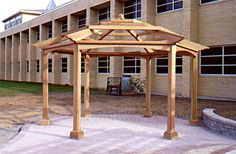 Hexagonal Pergola - This pergola, placed in a commercial courtyard, serves to create an accent in a large area of pavers and provides shade in an otherwise very exposed setting. The hexagonal pergola was designed at the request of the client as a counterpoint to the rectangular nature of the buildings and site. Lush plantings will add the finishing touches to complete the look and add additional shade. http://www.trellisstructures.com/pergolas/asp04-asian-style-pergola.html