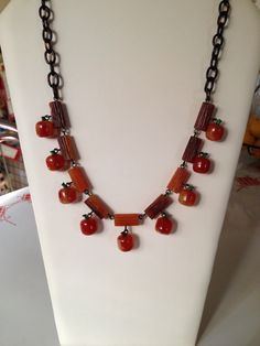 My first day of school necklace, bakelite logs and apples