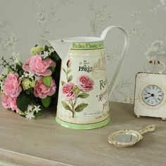 Floral french rose decorated metal jug. From the homeware and gifts collections, this is a Jug, that is made from metal and with mainly cream paint with a green base. Onto this background, there is a French theme of buildings and fields as well as roses. | eBay!