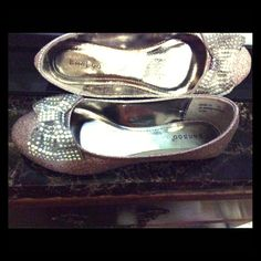 NEW...Ladies' Gold Color Flat Shoes Size 8.5 Dazzling Gold color shoes that shimmer of simulated Aurora borealis gemstone.   The gorgeous bow is adorned with simulated aurora borealis gemstones set on a silver/light gray base material that accentuates the gemstones.  ***Size 8 1/2 Shoes