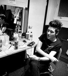 Dan singing into his phone