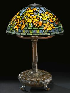 "Tiffany Studios""DAFFODIL"" TABLE LAMP, circa 1910 22 3/8  in. (56.8 cm) high 15 3/4  in. (40 cm) diameter of shade LOT SOLD. $75,000"