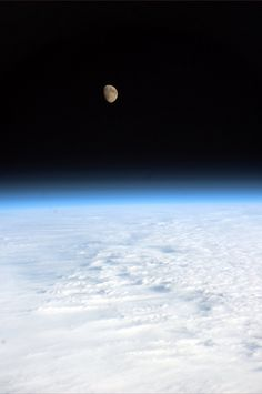 Moon Overhead (Credit: ESA/NASA) The Earth and the moon as seen on Jan. 15, 2011 from the International Space Station by astronaut Paolo Nespoli.