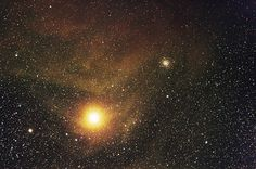 Massive red supergiant star Antares of the constellation Scorpius. It has a radius of over 800 times that of our Sun, is a little more than half as hot, and is about 11,000 times as bright. It's in the final phases of it's life and we could see it die in a supernova anytime within the next few million years and may potentially become a black hole. Antares has a smaller, blue companion star that orbits it once every 878 years or so.