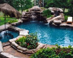 Love the color of the pool, the water feature and slide! The rocks are excellent, and the spa with an umbrella is interesting.
