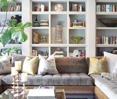 House & Home - paint the back of your bookshelf for added depth and decreased clutter.