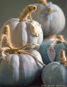 Embellish pumpkins with seashells. These are blue painted beachy pumpkins: http://beachblissliving.com/beach-pumpkins-fall/