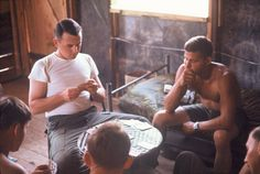 Helicopter crewmen of the 25th Aviation Battalion play cards.