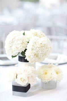 Modern Wedding Centerpiece | Photography: Jade + Matthew Take Pictures |  | Floral Design: A to Zinnias | See more: http://www.stylemepretty.com/georgia-weddings/savannah/2013/04/12/savannah-wedding-at-the-jepson-center-for-the-arts-from-jade-matthew-take-pictures