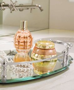 Reminiscent of five-star accommodations, the Belmont Personalized Oval Vanity Tray offers sophistication and functionality to your master suite.