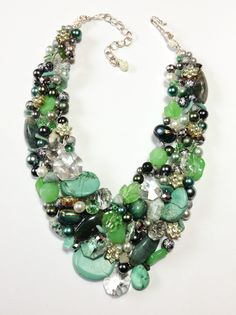 Spring 2014 statement necklace made of Crystal, moss agate, Amazonite, glass, stone, and rhinestone flowers.