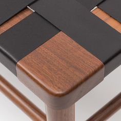 A detail on the Smilow Woven Leather Bench