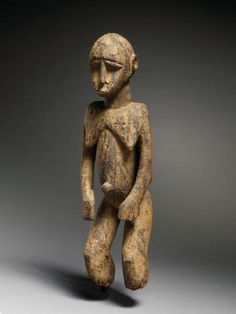 Lobi female figure (bateba), 19th century. Burkina Faso, northwest Ghana. Wood and surface encrustation.