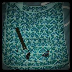 "Roxy Tote Large tote from Roxy by Quiksilver.  Cute blue logo pattern on light aqua background.  2 long handles that are perfect for either carrying at elbow or shoulder.  One large open compartment with one small zippered pocket on the front and large zippered pocket on back.  Has ""feet"" on bottom of bag to help keep fabric clean.  Includes keychain pictured. Roxy Bags Totes"