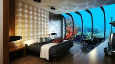 DUBAI underwater hotel room... Go to the site and theres video of inside the room! Like sleeping inside of a fishtank! So crazy!