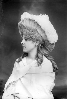 Elise Peeler wearing a large feather hat.