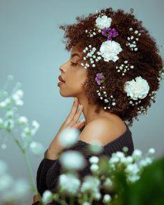 (@africanmelaninnn) curly fro. Flower hair. Natural hair curly hair. Curls.