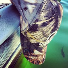 camo hat & a fishin' hook. mm, sure sign of a country boy.