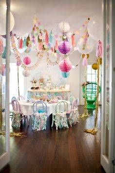 Sparkly Mermaid Party. So much going on with all the layered garlands, but so fun.