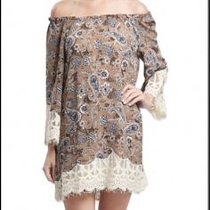 ⭐️⭐️Coming Soon⭐️⭐️Paisley Lace Dress Cute and comfy Off-the-shoulder dress. Embellished with a floral print of black, brown,  and neutral paisleys.  Hems defined with cream lace. Can be worn as a tunic top or dress.  trades. Price is firm.                                                  Size Small fits a 2/4.                                                  Size Medium fits a 6.                                                   Size Large fits 10/12. Trindy Clozet Boutique Dresses Long…