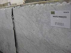 I like this granite the best.  White Princess Granite.