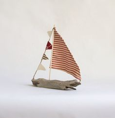 L - 11in x W - 2.25in x H - 11.5in Perfect piece of decor to finish off your favorite room. Driftwood was found on the shores of the Delaware River in Southern New Jersey. Hand selected after hours of beachcombing. Each sail boat is one of a kind and unique. For display only. Not a childs toy. Your Driftwood Sailboat will come in two pieces. You will need to insert the mast into the predrilled hole in the boat body ( 2 drops of glue not provided). Shipping only available in USA out of Los...