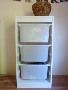 Ikea Trofast! Laundry Idea $39.99 Article Number: 301.711.23 The tall one I would buy 3 tall blue storage boxes and 1 small white storage box for things in pockets.