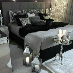 Navy fitted sheets, gray comforter and black throw with navy gray & black pillows