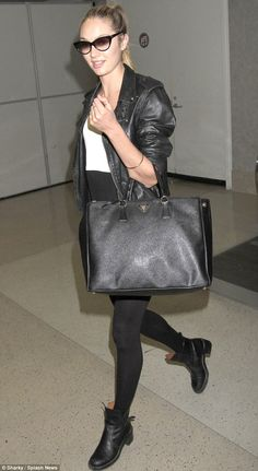 Runway style: Candice Swanepoel arrived to LAX on Thursday looking ready to hit the runway in an ultra chic black ensemble