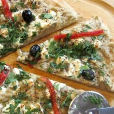 Arabic Pizza - Baba ganoush, black olives, feta cheese and roasted red peppers give this pizza an Arabic flair. Delicious!