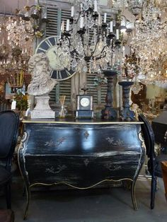 Look at this black gorgeous French Style bombe chest/sideboard  sorrunded with all the magnificent antique chandelier