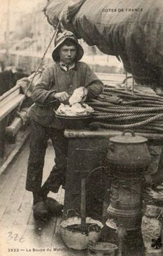The cabin-boy of a sailing coaster, preparing soup for the crew.