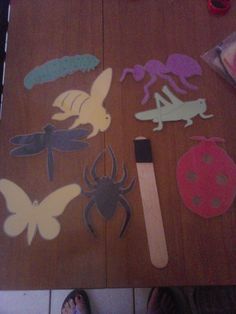 Magnetic Bugs; construction paper, laminate, hot glue magnets on the back, craft stick with magnet.