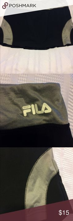 Fila tennis skort size - large. Fila black and gray tennis skirt has a lot to offer such as the hidden pocket in the waistband, drawstring in the waistband as well as pleats in the back of the skirt and attached spandex shorts underneath in excellent condition. Fila Skirts