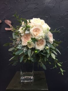 Fragrance Bridal bouquet with O'hara&Sweet Avalanche roses, white ranunculus, soft ruscus, eucalyptus berries, silver leaves.
