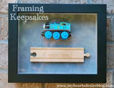 One of your kid's favorite childhood toys — engraved with their name and displayed in a shadow box.