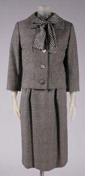 Woman's Suit: Jacket, Skirt, Blouse, and Belt