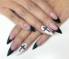 Black french stiletto nails with white accent nails with cross