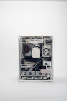 https://flic.kr/p/p1i853 | Macintosh SE with clear display case | Not much is known about this. It appears to be a sales tool for the Macintosh SE. The only label on it states: CAUTION!!! Computer must NOT  be connected to power source while display case is installed, since EMI emissions may occur. This product is not FCC approved, and should only be used for display purposes ONLY.