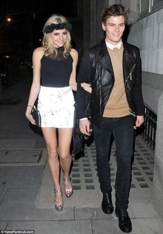 Birthday girl: Pixie Lott stands out in black and white as she heads out to celebrate her 22nd with boyfriend Oliver Cheshire