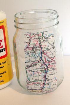 Mod Podge a map of your ancestor's hometown onto a clear glass jar.  When you visit their home (or where it stood), collect soil, sand, or whatever else is available and put it in the jar for a nice keepsake of where they -- and you -- come from.  Be sure to clearly label the lid so that your descendants know whose home it came from!