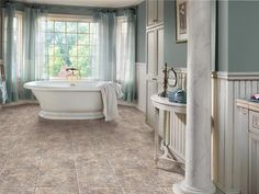 Stone-look vinyl tile is a practical choice. The surface is durable and easy to maintain, and the limestone composite construction prevents cracking. Shown: Ovations, Stone Ford. Photo courtesy of Congoleum Corporation Bathroom Flooring Options, Vinyl Flooring Bathroom, Vinyl Tiles, Flooring Ideas, Plank Flooring, Heated Tile Floor, Home Modern, Floor Colors, Floor Design
