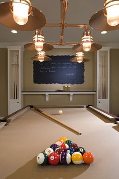 bar shelf and pool cue holders Chalkboard Painted Wall - traditional - basement - minneapolis - John Kraemer & Sons