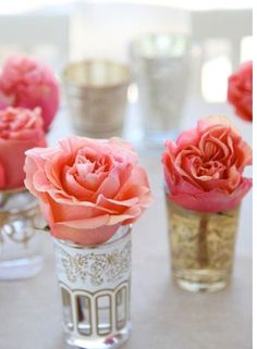 roses in votive cups