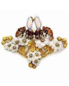 'Bees' pendant, by Paul-Émile Brandt, circa 1911. Designed as two bees with opal wings and enamelled bodies foraging on opal hawthorn flowers, the centre set with diamonds, mounted in gold. Signed ♥≻★≺♥