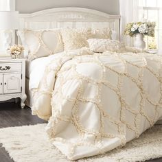 Add a touch of texture to your master suite or guest room with this charming comforter set, showcasing a ruffled trellis design.