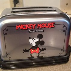 Disney Mickey Mouse toaster Plays Its a Small World. Works!