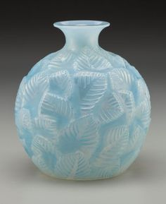 R. Lalique Opalescent Glass Ormeaux Vase with Light BluePatina. Circa 1926. Engraved R. Lalique, France