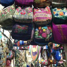 Bright bags and hammocks hang from the ceiling of the Mercado Guamilito in San Pedro Sula, Honduras   #travel #latinamerica