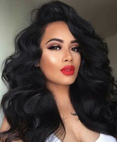 Soft, full hair and red lips! Get your holiday glam on with voluminous curls with a vintage feel. Wrap hair around a larger wand, let cool completely and brush through. Lifting the hair slightly, spray top and underneath with Big Sexy Hair Spray and Stay Hairspray for big volume and all day (and night) hold! https://www.sexyhair.com/products/spray-stay-intense-hold-hairspray.html